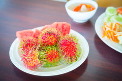 Rambutan on the plate. Ripe. Red Royalty Free Stock Photography