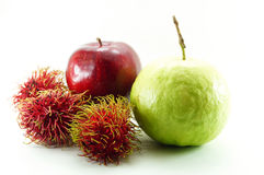 Rambutan,r ed ripe apple and guava Royalty Free Stock Photo