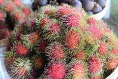 Rambutan. Red rambutan fruit in basket Stock Image