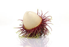 "Rambutan sweet delicious fruit isolated on white background. The name 'rambutan' is derived from the Malay-Indonesian languages word for rambut or ""hair Stock Photos"