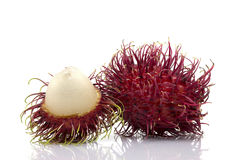 "Rambutan sweet delicious fruit isolated on white background. The name 'rambutan' is derived from the Malay-Indonesian languages word for rambut or ""hair Royalty Free Stock Photography"