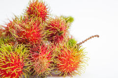 Rambutan sweet delicious fruit. On white paper background Royalty Free Stock Image