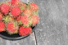Rambutan sweet fruit fresh in plate on wood background. Rambutan sweet t fresh in plate on wood background :Select focus with shallow depth of field Stock Photos