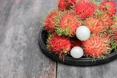 Rambutan sweet fruit fresh in plate on wood background. Rambutan sweet t fresh in plate on wood background :Select focus with shallow depth of field Stock Image