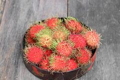Rambutan sweet fruit fresh in plate on wood background. Rambutan sweet t fresh in plate on wood background :Select focus with shallow depth of field Royalty Free Stock Image