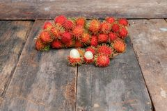 Rambutan sweet fruit fresh on wood background.  Stock Photos