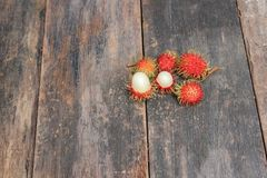 Rambutan sweet fruit fresh on wood background.  Stock Image