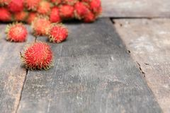 Rambutan sweet fruit fresh on wood background. Select focus with shallow depth of field Royalty Free Stock Image