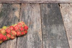 Rambutan sweet fruit fresh on wood background. Select focus with shallow depth of field Stock Images