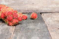 Rambutan sweet fruit fresh on wood background. Select focus with shallow depth of field Stock Photography