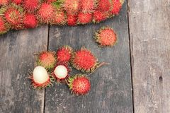 Rambutan sweet fruit fresh on wood background. Rambutan sweet t fresh on wood background :Select focus with shallow depth of field Royalty Free Stock Image