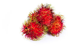 Rambutan a sweet tropical fruit. Close up of a group of rambutans isolated on a white background Stock Image