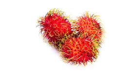 Rambutan a sweet tropical fruit. Close up of a group of rambutans isolated on a white background Stock Photography