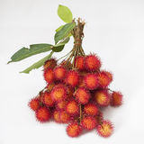 Rambutan. Thai with leaves  background Stock Photo