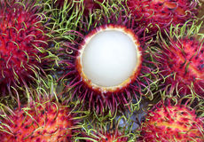 Rambutan Tropical Fruits Rambutan. Rambutan is a fruit with sweet red shell Stock Photos