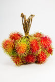 Rambutan on white backgruond. Stock Photos