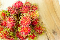 Rambutan on wood background. 