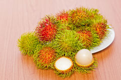 Rambutan on wood background. Fresh rambutan on wood background Royalty Free Stock Photography