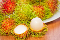 Rambutan on wood background. Fresh rambutan on wood background Stock Photography