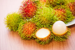 Rambutan on wood background. Fresh rambutan on wood background Royalty Free Stock Photos