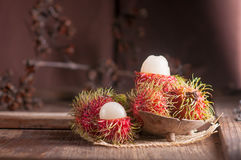 Rambutan on wood table.  Stock Images