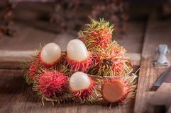 Rambutan on wood table.  Royalty Free Stock Images