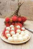 Rambutan. In wooden dish and knife on wood table Royalty Free Stock Photography