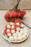 Rambutan. In wooden dish and knife on wood table Stock Photography