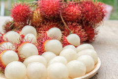 Rambutan. In wooden dish on wood table Stock Photography