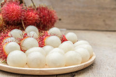 Rambutan. In wooden dish on wood table Royalty Free Stock Images