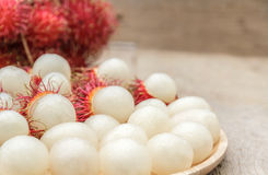 Rambutan. In wooden dish on wood table Stock Photo