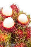Rambutans. Tropical fruit, rambutan on white background Royalty Free Stock Photos