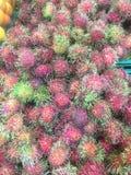 Rambutans bakgrund, till salu rambutan, frukt av Thailand, Ubonr Royaltyfria Foton