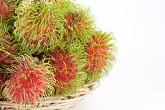 Rambutans in a basket Stock Image