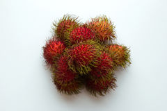 Rambutans closeup on the white background. Red rambutans closeup on the white background Stock Photography