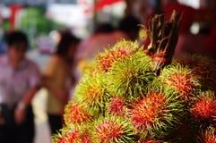 Rambutans, exotic fruits. Rambutans, asia exotic fruits on sale at street Royalty Free Stock Photos