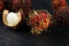Rambutans fruit with leaf on table. Rambutan or hairy lychee.  Stock Photography