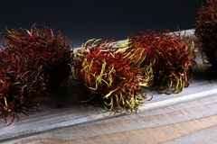 Rambutans fruit with leaf on table. Rambutan or hairy lychee.  Stock Photos