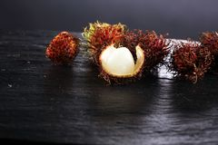 Rambutans fruit with leaf on table. Rambutan or hairy lychee.  Royalty Free Stock Image