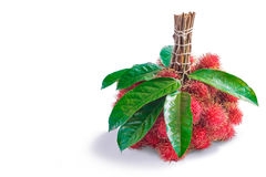 Rambutans fruit with leaf. On white background Royalty Free Stock Photo