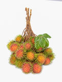 Rambutans fruit. With leaf on white background Stock Images