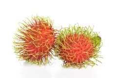 Rambutans fruit with leaf on white background. Rambutans fruit with leaf on white background Royalty Free Stock Photography