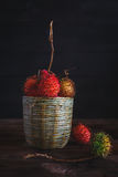Rambutans. On the old dark background Stock Images