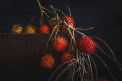 Rambutans. On the old dark background Stock Photos