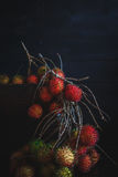 Rambutans. On the old dark background Royalty Free Stock Photography