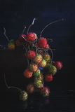 Rambutans. On the old dark background Royalty Free Stock Photos