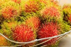 Rambutans. Rambutan, tropical fruit on white background Stock Photos