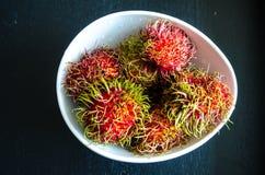 Rambutans ripe tropical fruits. Studio Photo Royalty Free Stock Photos