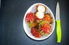 Rambutans ripe tropical fruits. Studio Photo Royalty Free Stock Photo