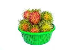 Rambutans tropical fruit on basket. Rambutans tropical fruit on green basket in Thailand Stock Photos